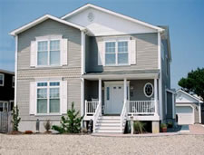 Open floor plan narrow lot custom designed modular home with 4 or 5 bedrooms, 3 full baths at the Jersey Shore.