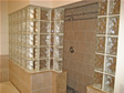 Decorative glass blocks add a creative touch and beautiful privacy wall to this master bath shower