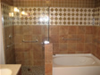 RBA Homes works with the customer to design and install tile as shown in this custom bathroom
