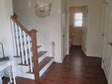 Stairs and railings can be custom designed and include hardwood to match the floors.