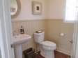 Notice the beautiful Wainscoting and comfort height toilets in this modular home.