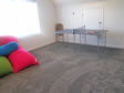 Playroom area on second level of this modular cape home provides lots of open space.