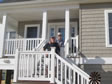 Our happy home owners on the porch entry to their new modular home.