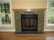 Large gas fireplaces with stone surrounds provide a strong and stately look to this modular home
