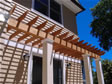 Building a Pergola over a rear deck provides shade, beauty and privacy to any backyard