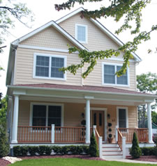 Middletown, NJ narrow lot home with long front porch and stately columns provides a nice look and functionality.